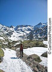trekking through snow valley
