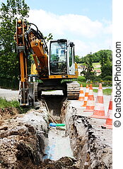 Laying a trench to provide utilities to a residential house using an excavator