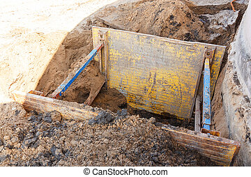 Trench to repair the pipe break.