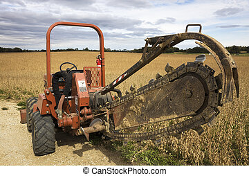 Old style trenching machine in the field.