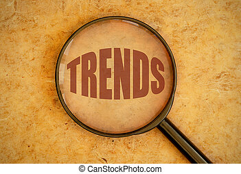 Trends - Magnifying glass focusing on trends