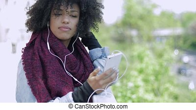 Trendy African woman with smartphone - Young African woman...