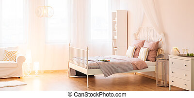 Trendy bedroom with canopy bed