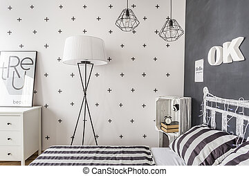 Trendy black and white contrast - New style bedroom with...