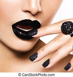 Trendy Black Caviar Manicure and Black Lips. Fashion Makeup