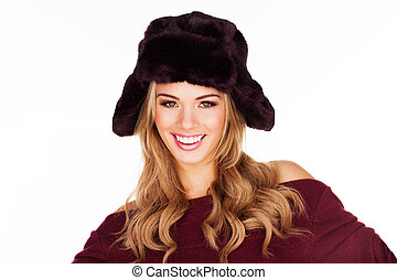 Trendy blond woman in a black hat