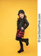 Trendy cool girl on orange