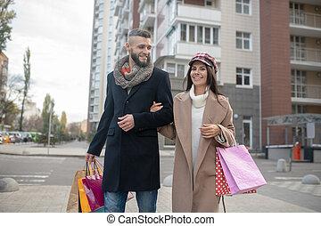 Pretty happy woman holding her boyfriends hand