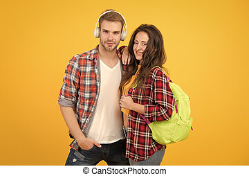 trendy dressed students. back to school. People lifestyle concept. university student dating. Two cheerful students. study together. girl carry backpack. man listen music in headset. feeling carefree