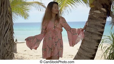 Trendy ethnic lady leaning on palm