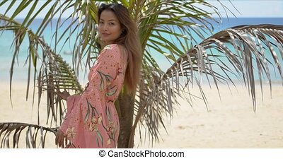 Trendy ethnic lady near palm leaves on beach - Stylish ...