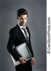 Trendy fashion young businessman black suit