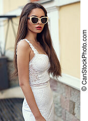 Trendy girl wearing sunglasses