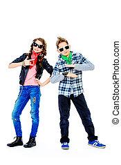 trendy kids - Modern teenagers posing together. Full length...