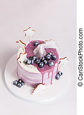 Trendy lilac round mousse cake with mirror glaze, pear,...