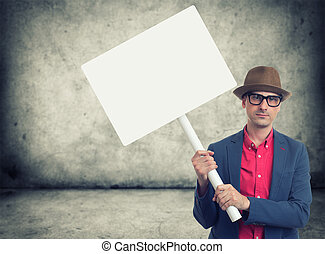 trendy man holding protest sign - trendy man holding blank...