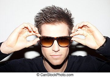 Trendy Man In Sunglasses - Trendy young man with spiky hair...