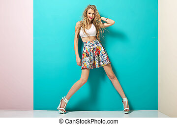 Trendy outfit of young blonde lady