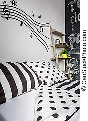 Trendy patterned bedroom with musical accents
