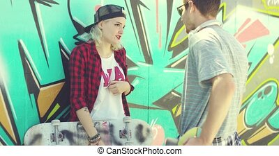 Trendy urban girl chatting with her boyfriend