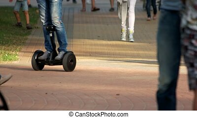 Trendy urban transportation gadget. Man riding gyroscooter,...