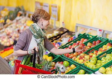 Trendy woman buying fresh produce