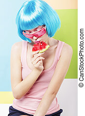 Trendy Woman in Blue Wig and ping Glasses Eating Watermelon