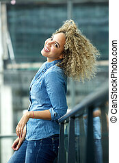 Trendy young african american woman smiling