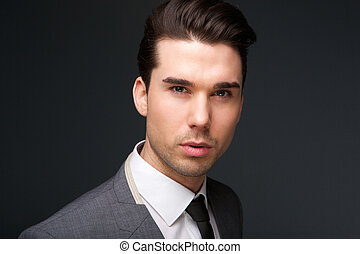 Trendy young man in suit and tie