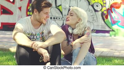 Trendy young urban friends relaxing chatting