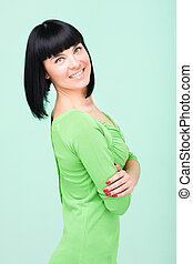 woman in green dress smiling