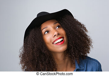 Trendy young woman smiling with hat