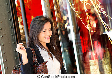 Trendy young woman walking in town