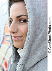 Trendy young woman wearing hooded sweater