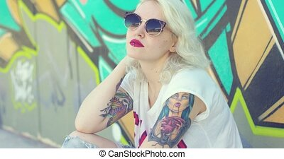 Trendy young woman with a vampire tattoo
