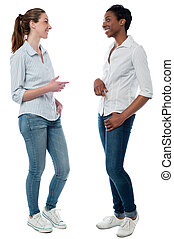 Trendy young women having a discussion