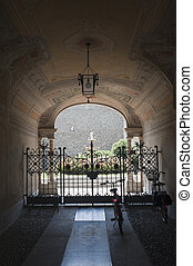 Treviglio (Bergamo, Lombardy, Italy), entrance of historic palace with two bicycles