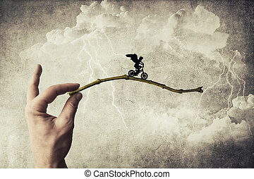 Boy riding a bicycle try to jump over a chasm. Self overcoming and risk taking concept