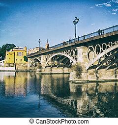 Triana Bridge - The Isabel II bridge in Seville, Spain....