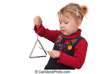 Triangle - Little girl playing a triangle instrument on...