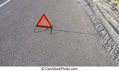 triangle the warning triangle standing on the road