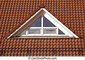triangular plastic window on the roof with tiles