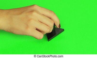 Triangular stamp. Close up. Green screen