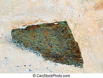 Triangular stone in a wall