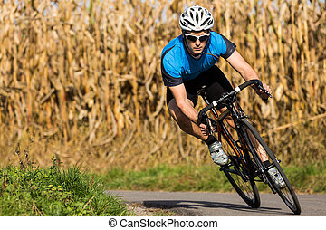 triathlete in cycling - triathlet on a bicycle