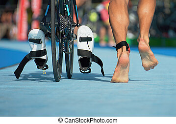 Triathlon bike the transition zone,detail of the legs