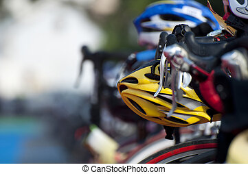 A cyclist helmet sitting on the bike waiting to be used at the transiation phase of the Triathlon.
