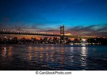 Triborough bridge and Manhattan city at night, New York