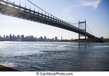 Triborough bridge over the river and Manhattan city, New York