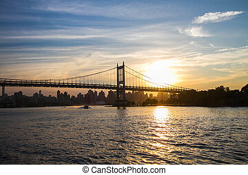 Triborough bridge over the river and sunset, New York